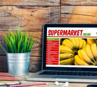 Supermarket online shop website in a laptop at the office.